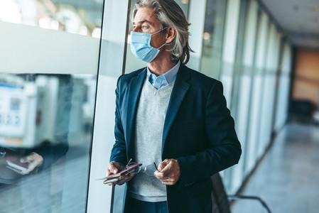 Business traveler wearing mask