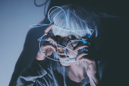 Weird dystopian theme portrait with blue neon lights