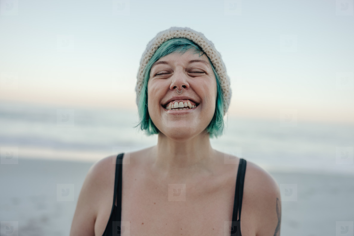 Cheerful winter bather smiling with her eyes closed