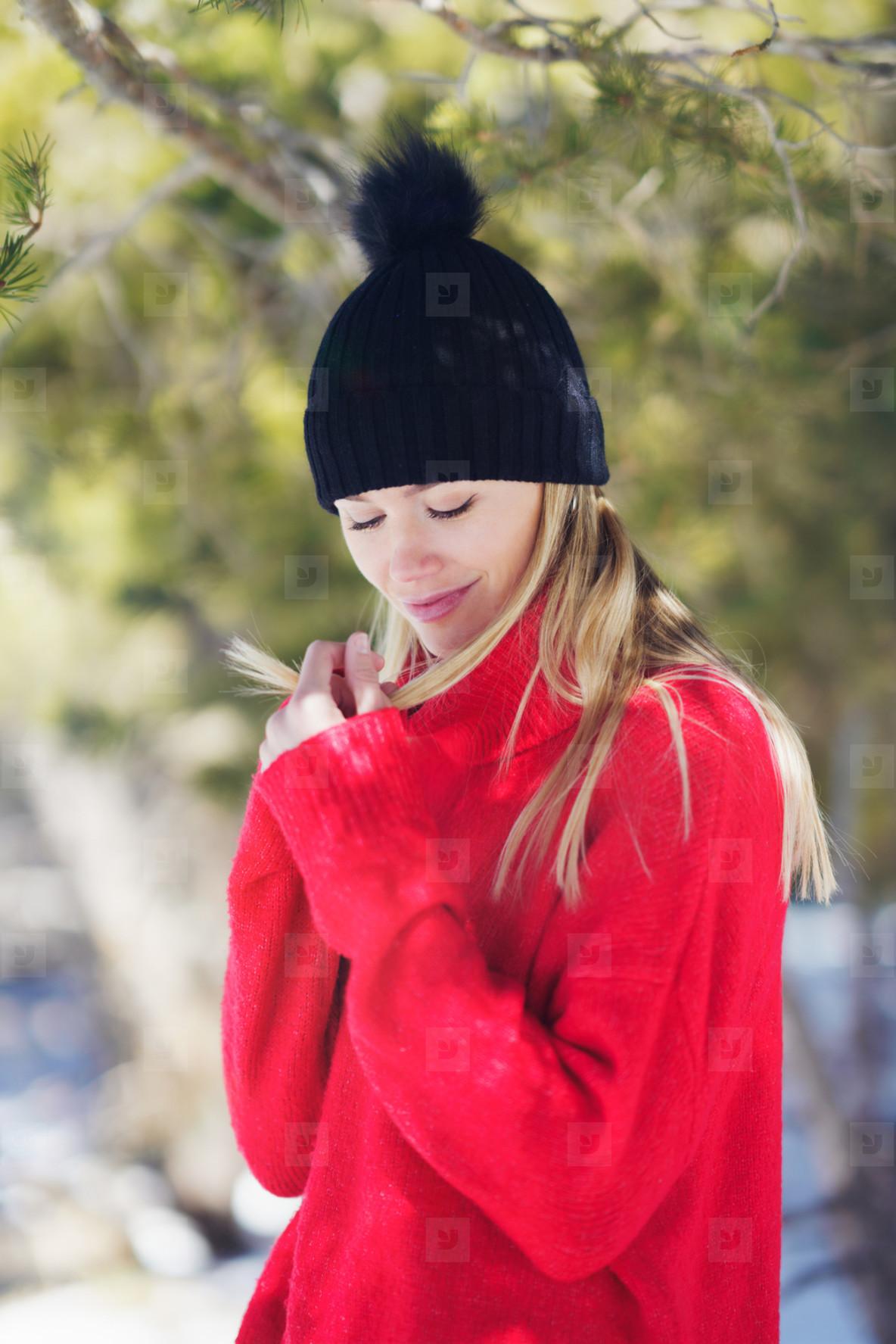 Sweet blonde woman in a snowy forest in the mountains in winter  in Sierra Nevada  Granada  Spain