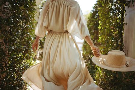Unrecognizable tourist woman in an elegant dress