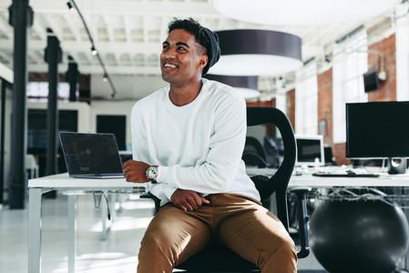 Happy software developer smiling in a modern office