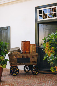 Still life of a trolley cart with travelling bags outside a hote