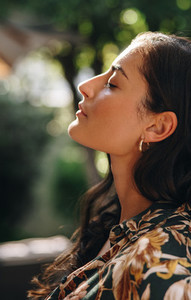 Beautiful young woman with her eyes closed