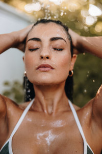 Attractive woman showering outdoors