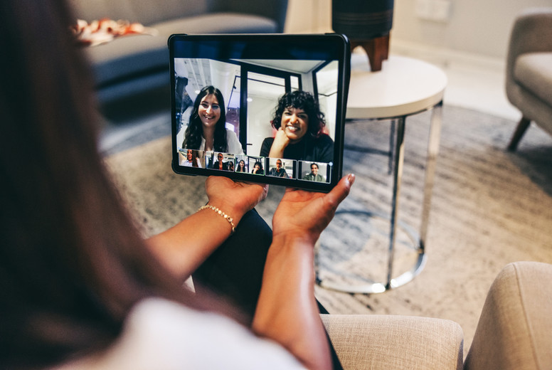 Female entrepreneur attending a virtual meeting with her global partners