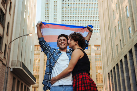Gender nonconforming couple celebrating gay pride outdoors