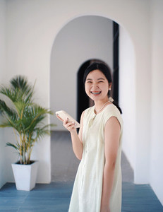 Happy young asian millennial woman smiling with braces in casual