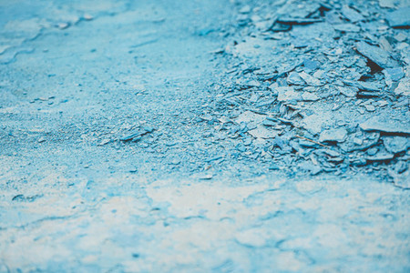 Abstract texture of cracked blue paint