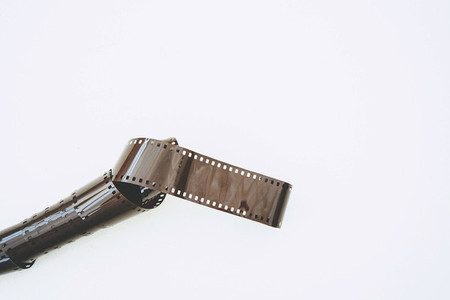 Minimal image of a old film roll against white background