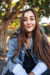 Cute teenage girl looking at the camera outdoors