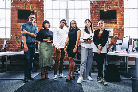 Diverse team of businesspeople standing together in an office