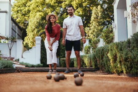 Couple playing petanque together