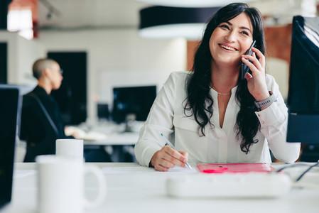 Businesswoman making phone calls