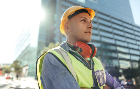 Blue collar worker looking thoughtful in the city