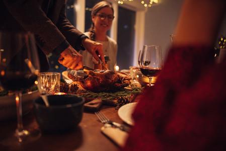 Family having Christmas dinner at home