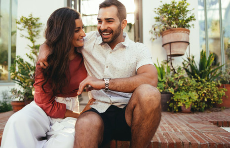 Cute couple laughing together outside a hotel
