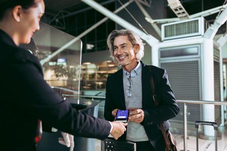 Man showing electronic ticket