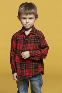 Portrait serious boy in plaid shirt