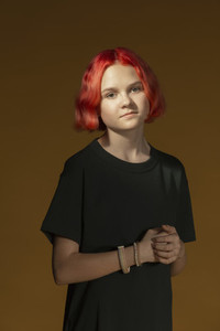 Portrait confident teenage girl with short red hair
