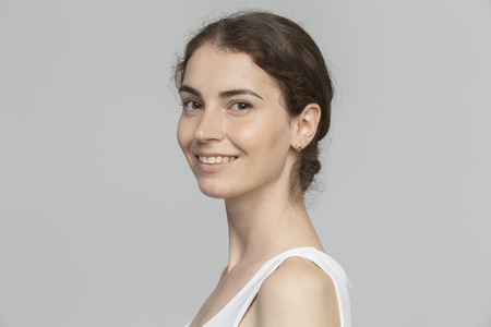 Portrait smiling young woman against white background