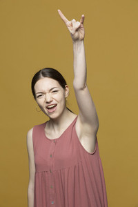 Portrait excited young woman cheering