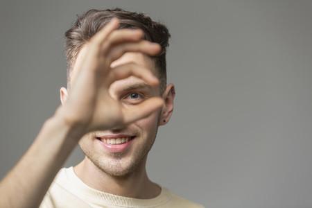 Portrait happy young man gesturing