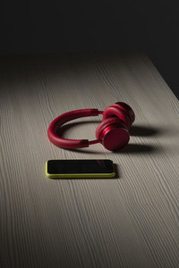 Headphones and smart phone on table