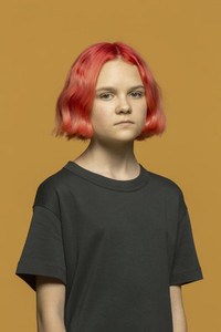 Portrait serious teenage girl with dyed red hair