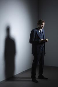 Businessman in suit using smart phone