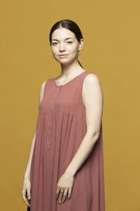Portrait confident beautiful woman in dress
