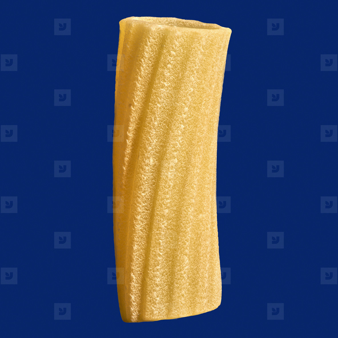 Close up uncooked penne rigate noodle on blue background