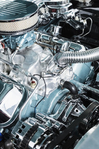 Close up chrome parts in car engine