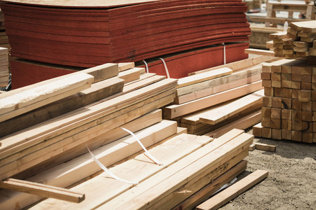 Stacks of wood boards and plywood