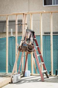 Tool belt hanging on ladder at construction site
