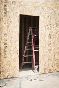 Ladder inside construction site doorway