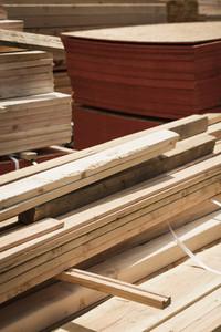Stacks of wood planks and plywood at lumberyard