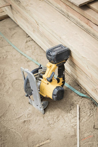 Power saw leaning against wood board