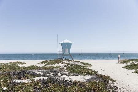 Lifeguard hut on sunny idyllic ocean beach California