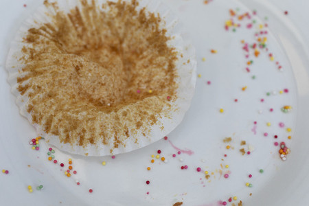 Cupcake wrapper and sprinkles on plate