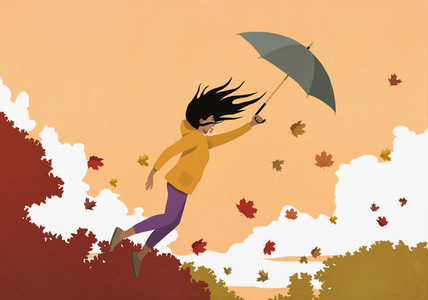 Woman with umbrella flying in autumn wind