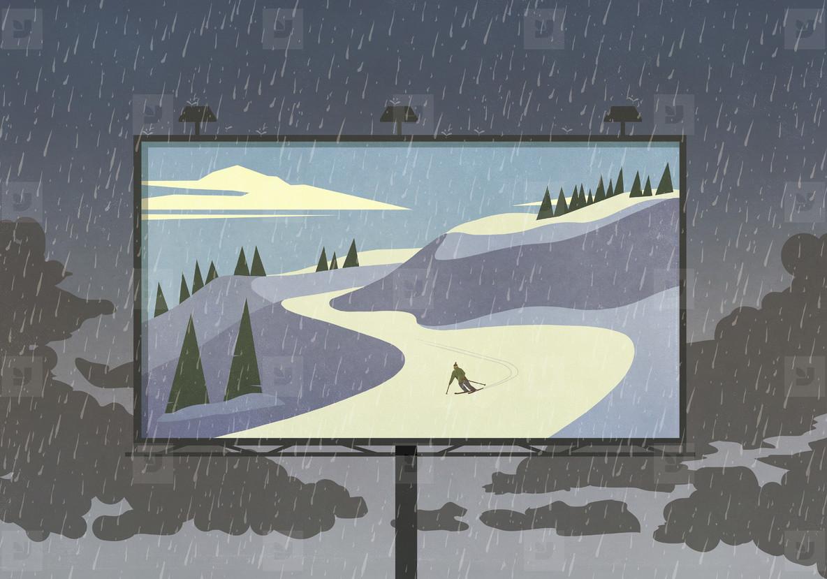 Skier on snowy slope on billboard against rainy sky