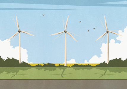 Wind turbines spinning in sunny idyllic rural field