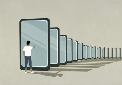 Man standing at smart phone dominoes