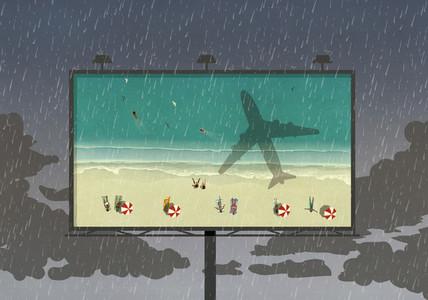 Tourists at beach on billboard against rainy sky