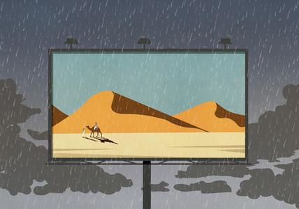 Camel and desert scene on billboard against rainy sky