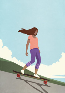 Teenage girl riding skateboard