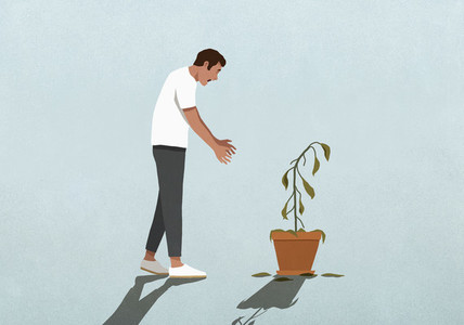Surprised man looking down at dead houseplant