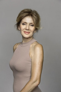 Portrait beautiful mature woman on gray background