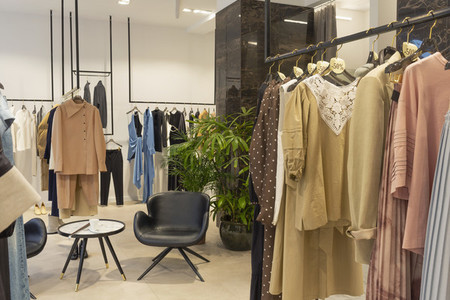 Clothing on racks in boutique